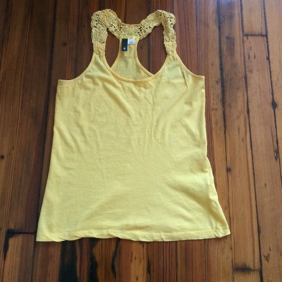 Beautiful yellow Racerback tank with lace Beautiful yellow Racerback tank top with lace to add a little bit more of a feminine touch. This tank goes with anything and give you that pop of color all year round.   Bundle and save 10% off on 3 items and save on shipping. Open to fair and respectful negotiations. Tops Tank Tops