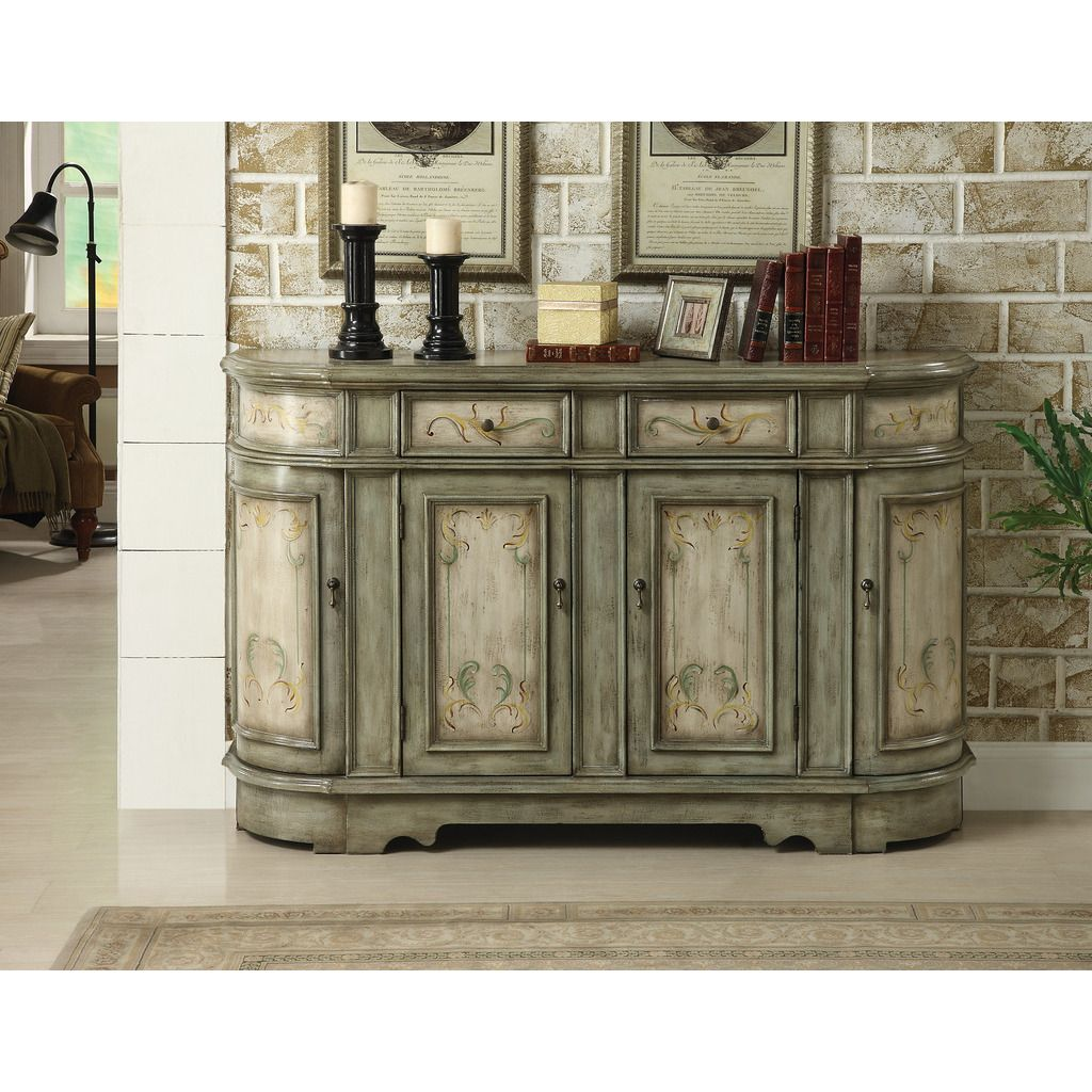 This cabinet makes a perfect decorative centerpiece for your home and can be used as a buffet or bar console. It has an antiqued finish and design that give it a comfortable, warm appearance that you will appreciate immediately.