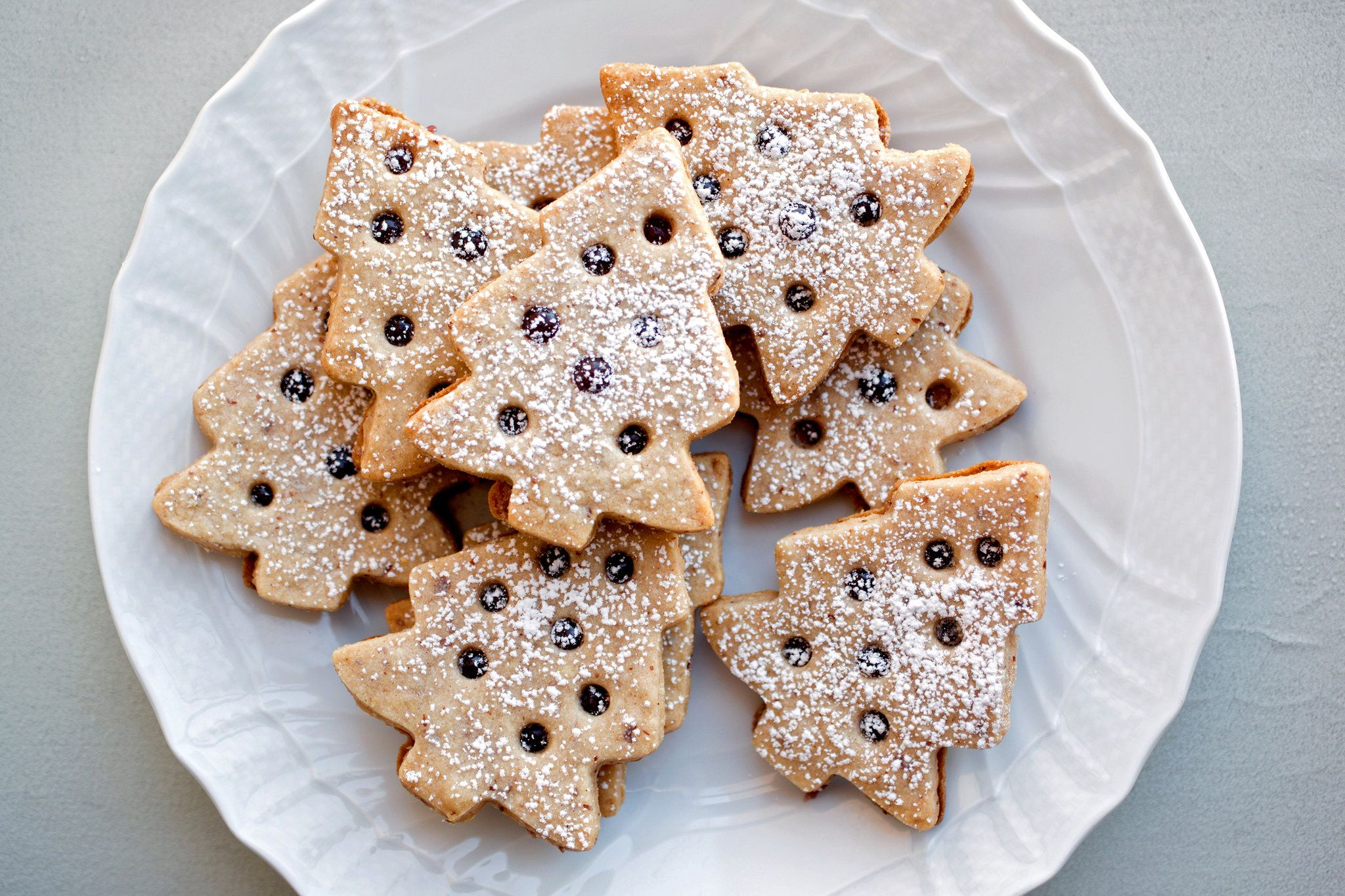 """These are a reworking of an old """"Joy of Cooking"""" recipe I learned from my friend in Atlanta, Allison Dykes They are the precious stars of her holiday cookie plate The dough can be slightly finicky but can be re-rolled and re-chilled several times so all the scraps get used"""