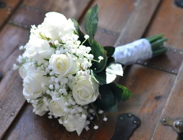 Weddbook is a content discovery engine mostly specialized on wedding concept. You can collect images, videos or articles you discovered  organize them, add your own ideas to your collections and share with other people - This timeless bouquet is made of ivory, white silk roses with babies breath. This size bouquet is perfect for a brides bouquet and measures