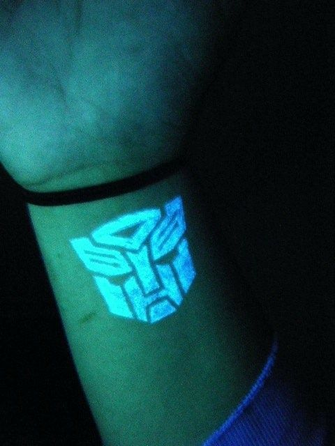 Autobot symbol in UV ink. My favourite tattoo I have so far. Peep The Tatts. | tattoos picture uv tattoos