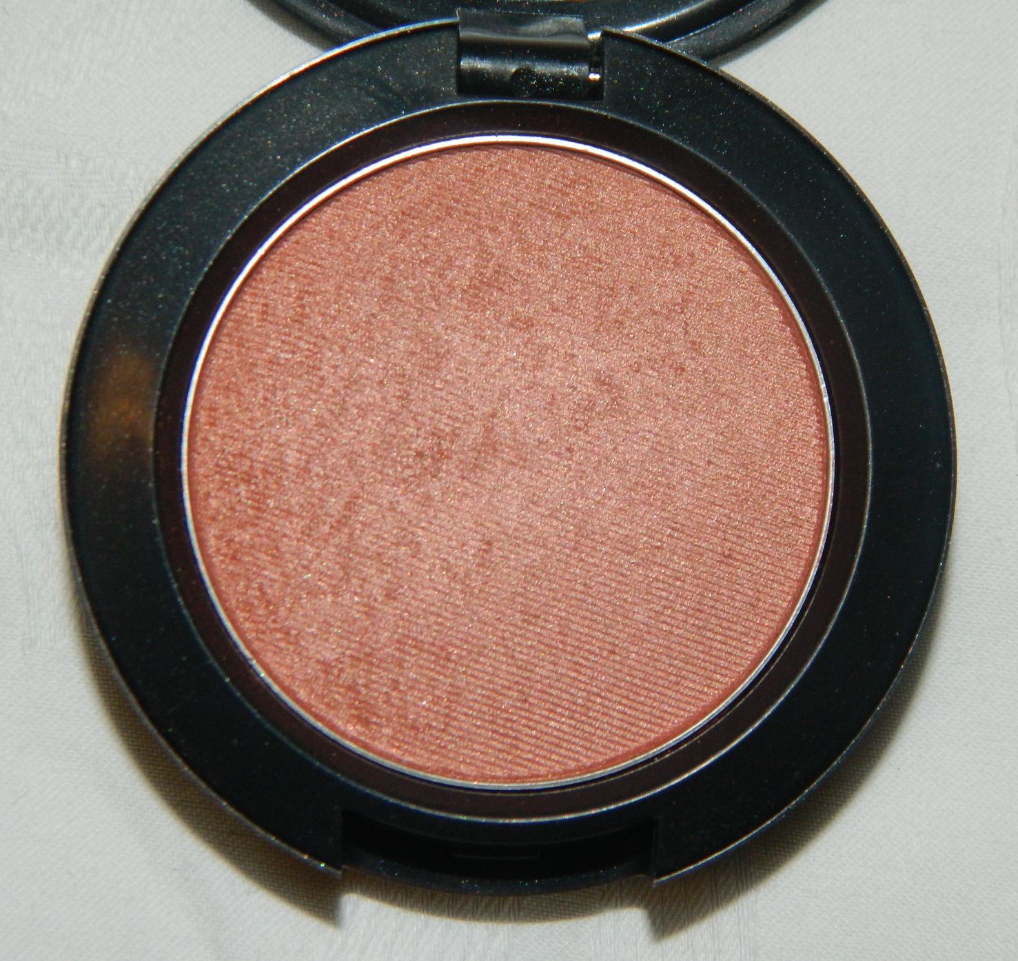 MAC Margin Powder Blush...A dirty peach color with shimmer that ...