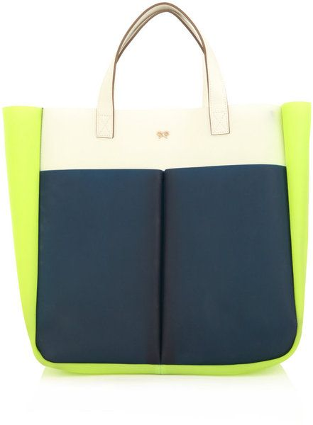 Anya Hindmarch. Neon and dark blue handbag