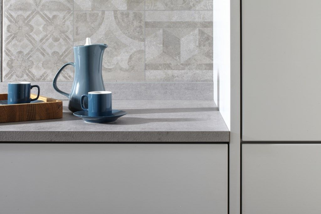 Burbidges Otto Kitchen In Concrete And Matt Light Grey Matt Light - Grey cupboard doors