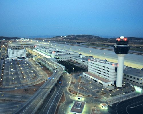 "Athens International Airport (Greek: Διεθνής Αερολιμένας Αθηνών) known as ""Eleftherios Venizelos"" (Greek: Ελευθέριος Βενιζέλος), began operation on 29 March 2001 and is the primary civilian airport that serves the city of Athens and the region of Attica. The airport is the major hub and base of Aegean Airlines and Olympic Air. The airport serves more than 14 million travellers annually and its name honours the Greek statesman Eleftherios Venizelos."