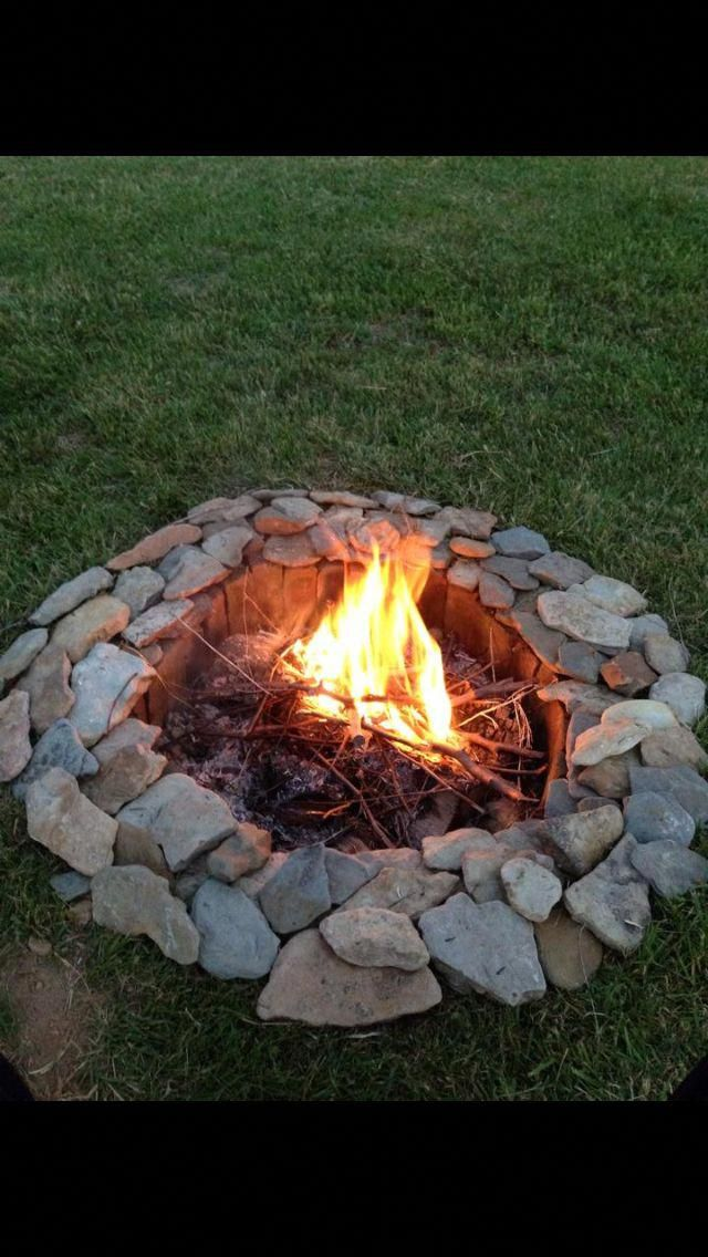 Photo of Creek rocks and bricks make a great fire pit