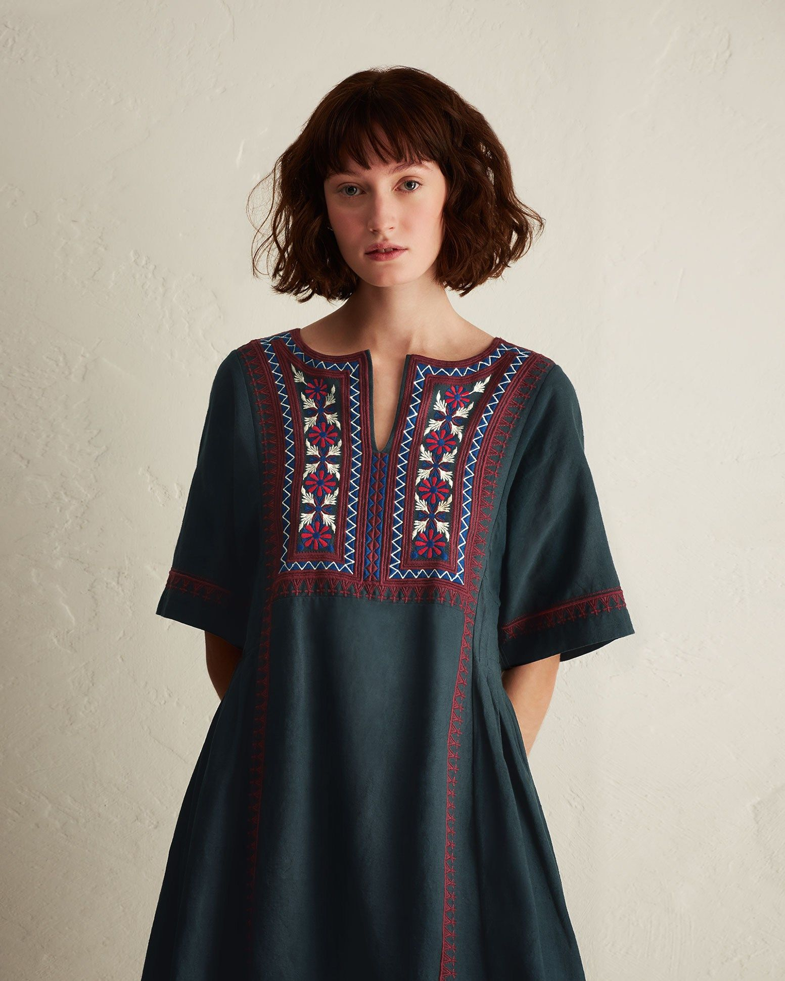 f501a8570541 EMBROIDERED KAFTAN DRESS | Hand spun and hand woven cotton khadi. Kaftan  neckline. Hand embroidered front panel. Above elbow-length sleeves.