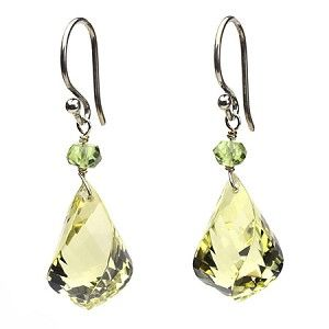 These uniquely cut lemon citrine earrings are faceted all the way around and down their spiral cut, so they sparkle like crazy. They are unique and fun to wear and appropriate in every setting. They can be worn everyday or at a special occasion. Finished with sterling silver and accented with a faceted peridot bead. www.candybeadsjewelry.com