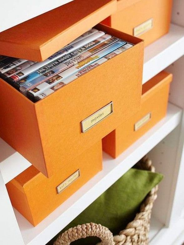 Labeled photo boxes are stylish and the perfect size for stashing on shelves in a entertainment center