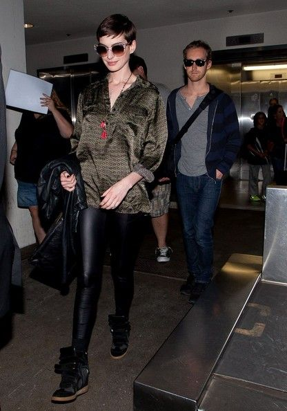 Anne Hathaway Photos: Anne Hathaway and Adam Shulman at the Airport