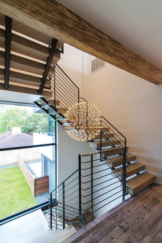 The Open Stair Treads, Metal Guardrail And A Sphere Chandelier.