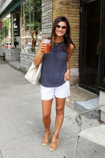White shorts and unique navy tank top, looser fit and not low cut.
