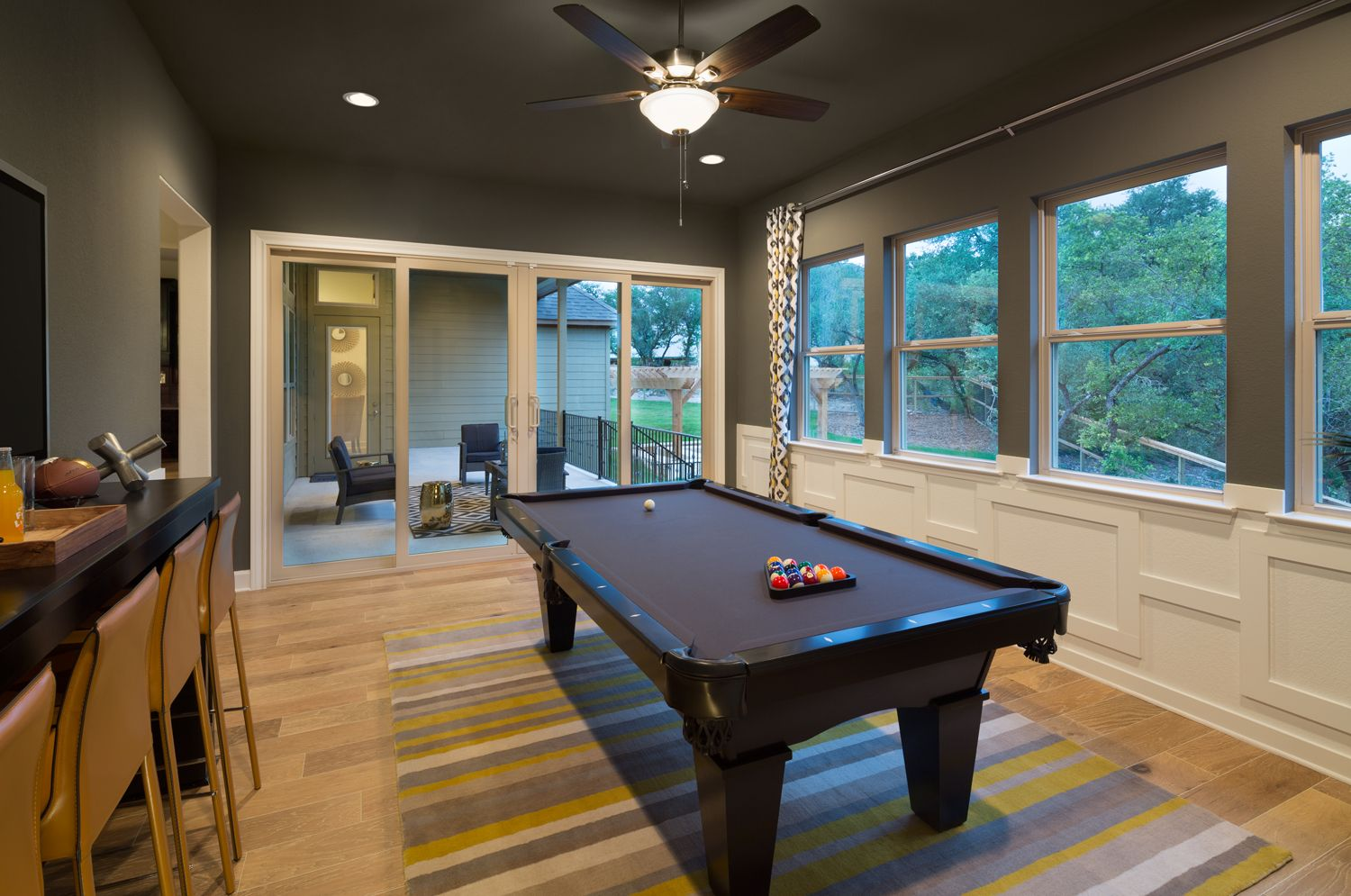 Game Room with large sliding glass doors to outdoor living