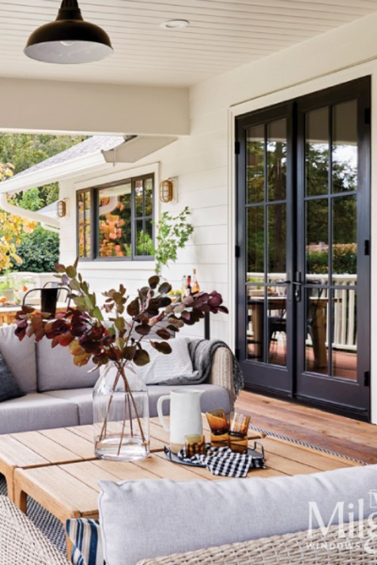Black french patio doors add an dark elegance to this