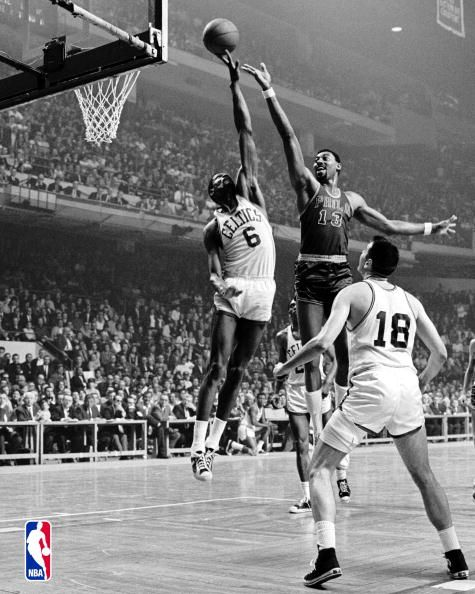 Bill Russell blocks Wilt Chamberlain as Bailey Howell looks on. Bill Russell is probably the best defensive basketball player to ever play the game.
