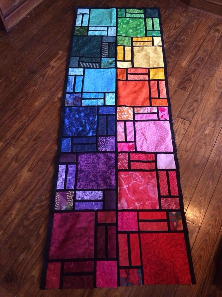 Let these beauties brighten your day...check out these stained glass quilts! Scrappy colorful quilted table runner