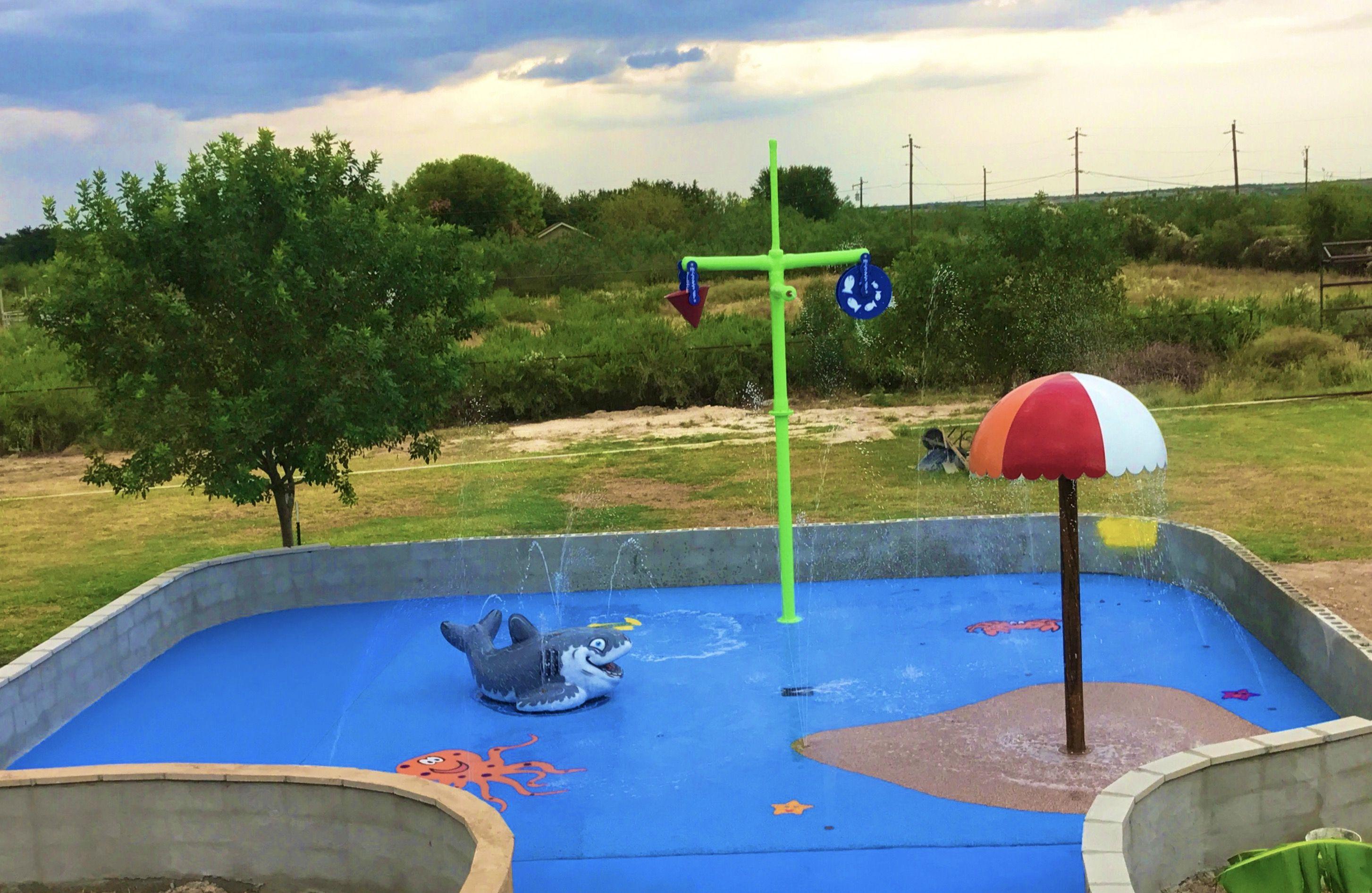 We Installed This Unique Splashpad In Del Rio Tx We Manufactured The Beach Umbrella Double Fun Water Wheel A Backyard Splash Pad Splash Pad Backyard Design