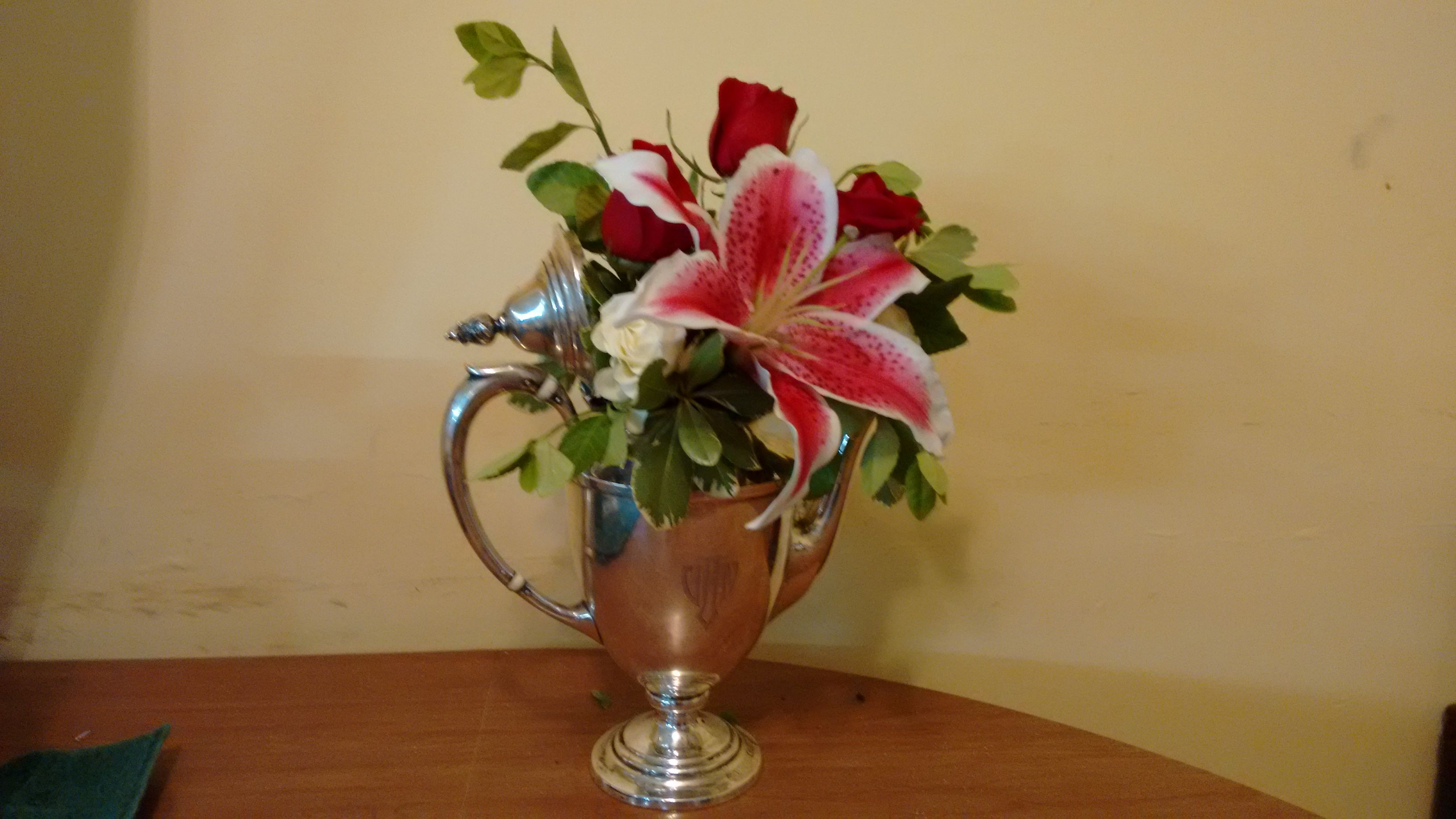 Antique silver teapot arrangement