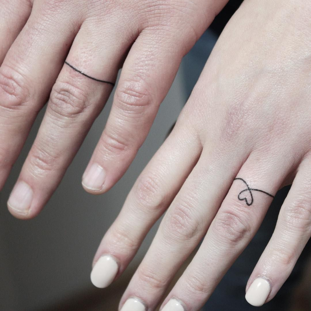 16 Wedding Ring Tattoos We Kind of LOVE Wedding ink that
