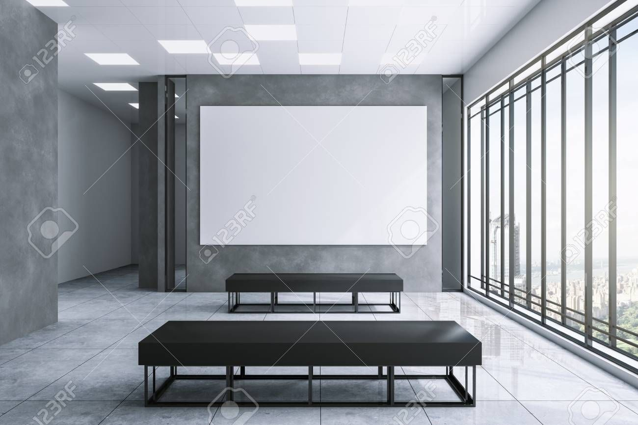 Clean exhibition hall interior with empty white banner on concrete wall city view and daylight Gallery concept Mock up 3D Rendering