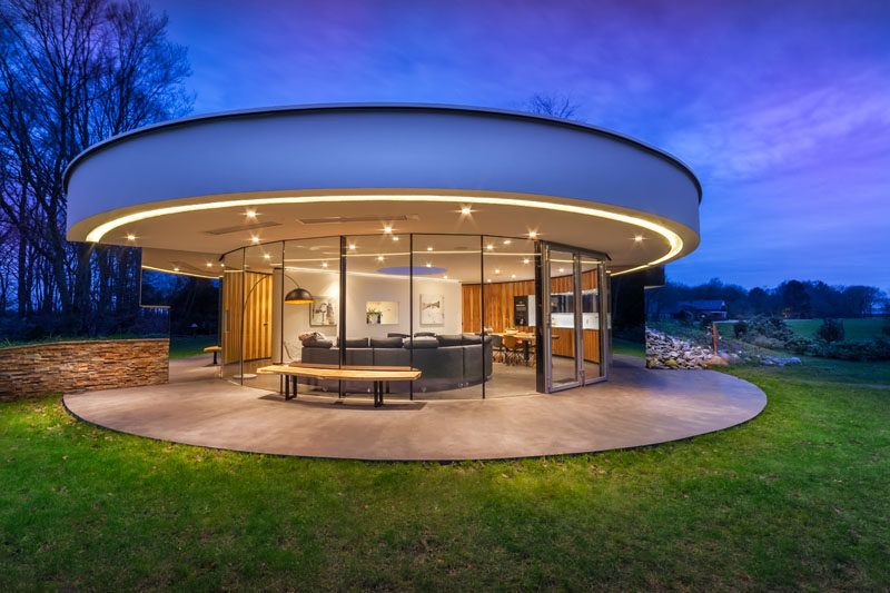 This Circular House Is Built Into The Hillside Villa Design Craftsman House Plans Modern Architecture Design