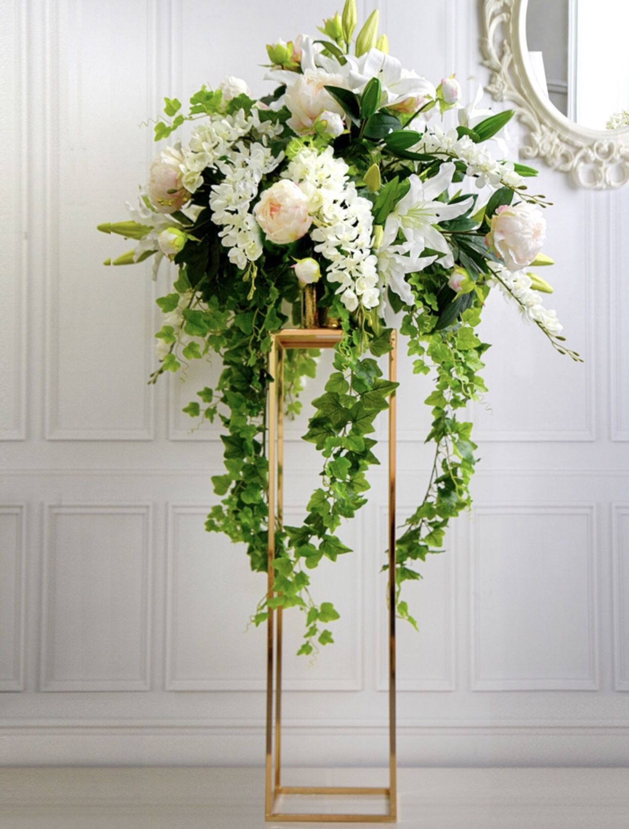 These tall gold flower stands make a striking centrepiece