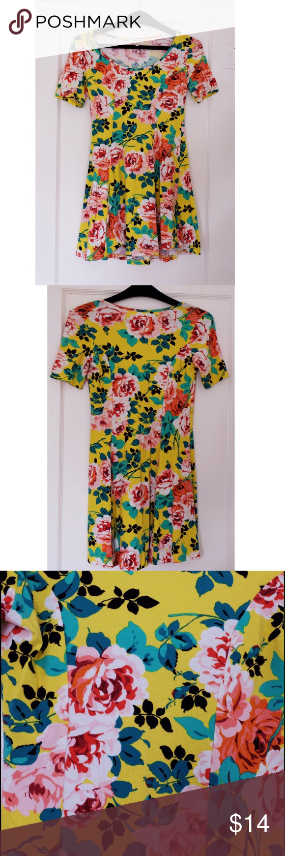 Springy Floral Dress by Monteau Fun spring dress with slight flare at the bottom. This colorful cotton capped sleeve dress is soft and extremely comfortable! The main color is a bright yellow and is decorated with pink florals and green leaves. Only worn once! Monteau Dresses Mini