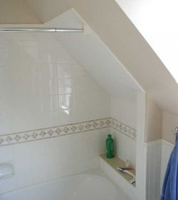 Tiled Tub Shower Combo With Slanted Ceiling Except Use