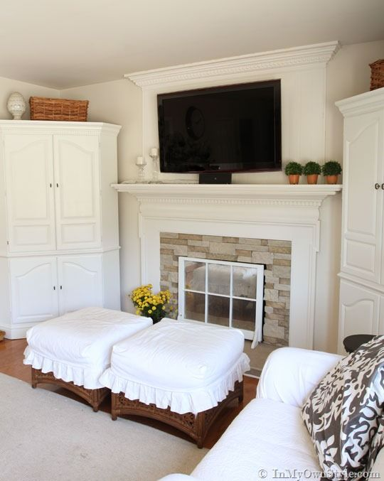 Hide-the-cords.....love the whole fireplace, the corner cabinets ...