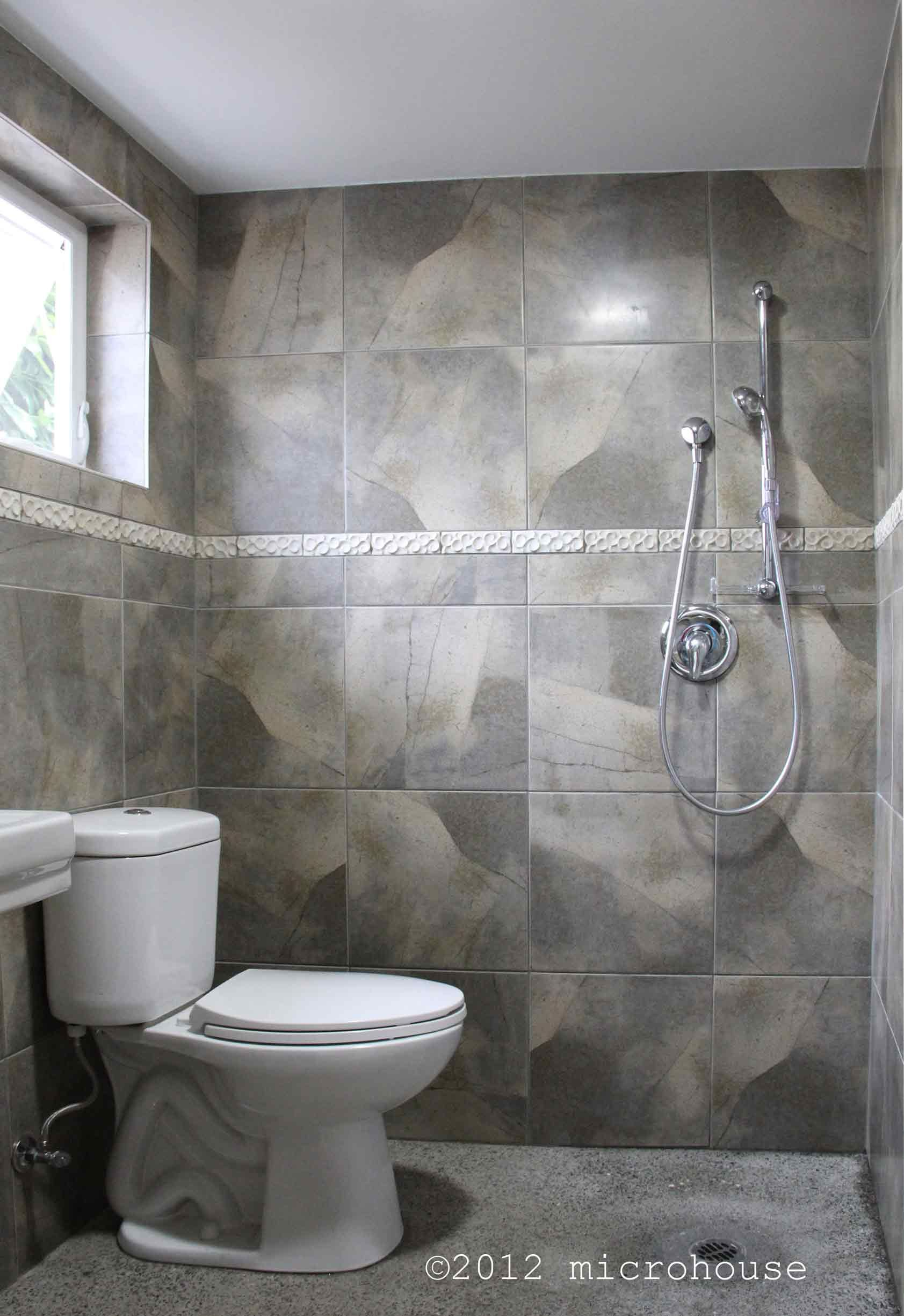 The wet room bath is easy to clean and the toilet doubles as a ...