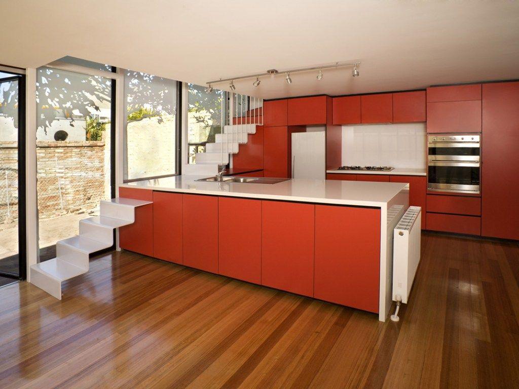 orange-kitchen-appliances-and-14-under-staircase-dark ...