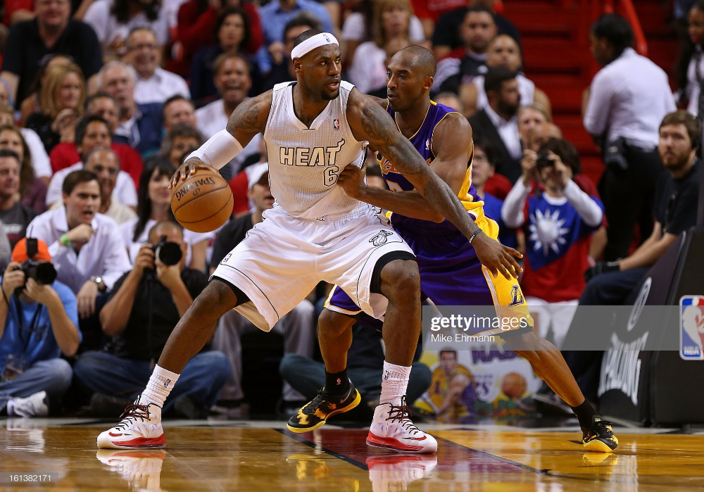 Kobe Bryant of the Los Angeles Lakers guards LeBron James