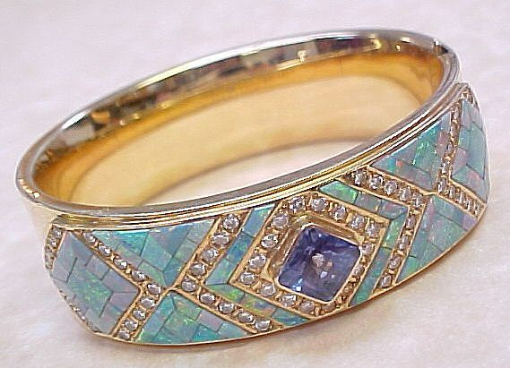 Lavish jeweled bangle, mosaic opal, tanzanite, and diamonds.