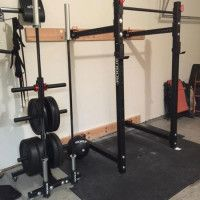 rogueequipped garage gym with folding power rack  home