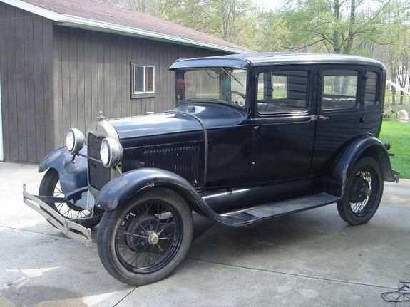 1929 Ford Model A Four Door Sedan Maintenance Of Old Vehicles The Material For New Cogs Casters Gears Could B Old Classic Cars Classic Cars Trucks Ford Models