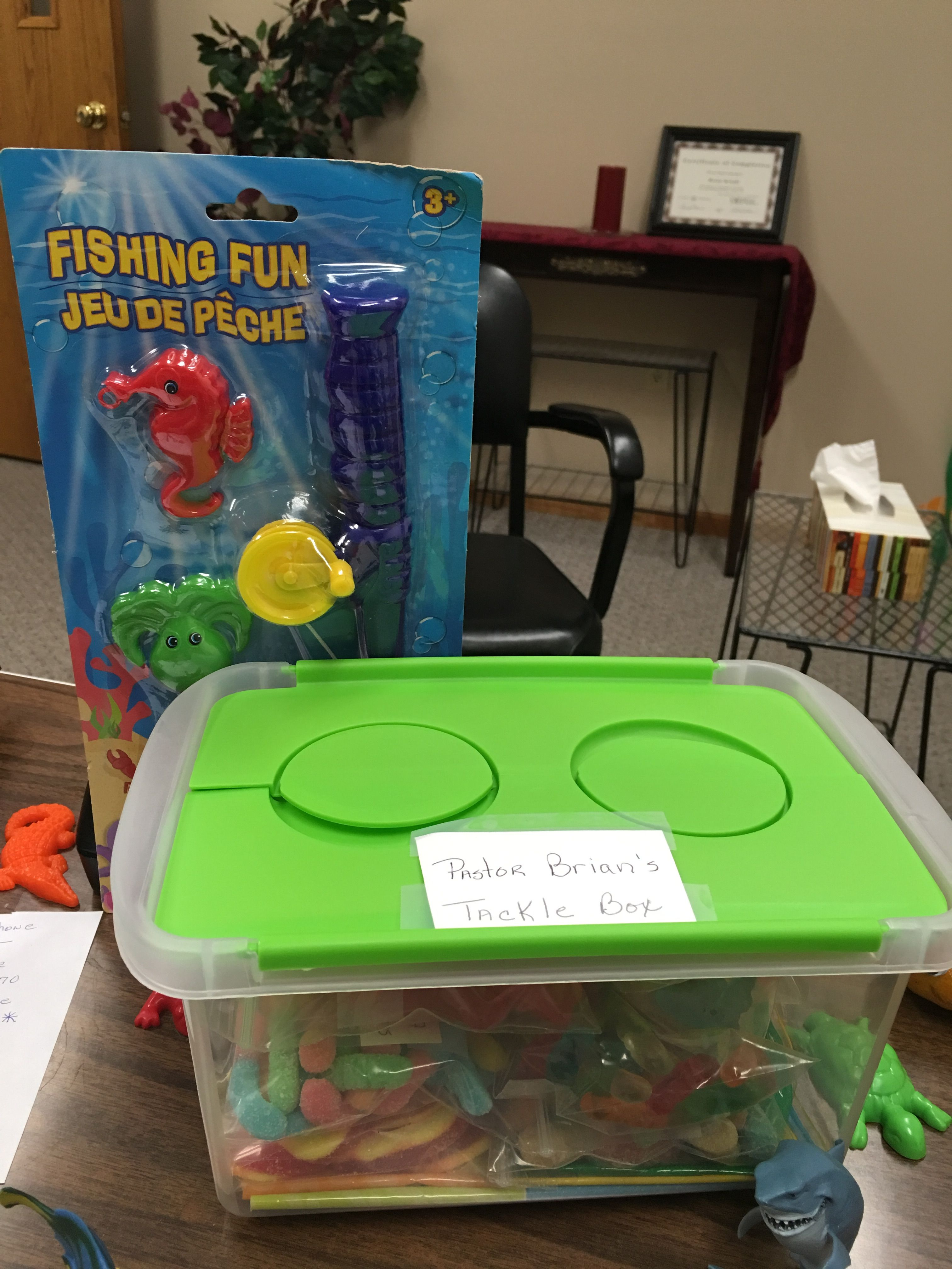 A tackle box was filled with gummy worms and fishes the
