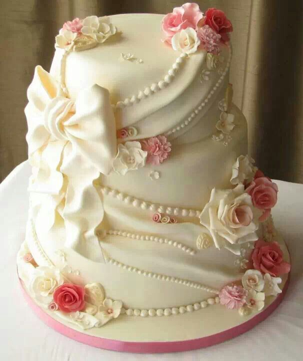 Ribbon and roses wedding cake.