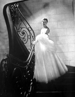 Model wearing a gown by Balenciaga for Vogue Paris, 1951.