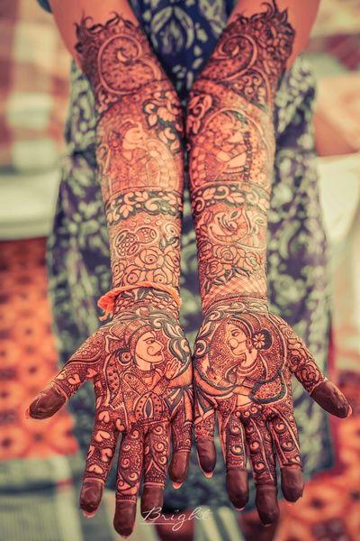 Mehendi Designs - Intricate Mehendi Design with Bride and Groom Caricatures   WedMeGood #indianbride #indianwedding #mehendidesign #mehandi #bridalmehendi #henna #tattoo #bridal #indianbride
