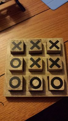 Tic tac toe. I'm not sure where this photo came from but I must make one! :)