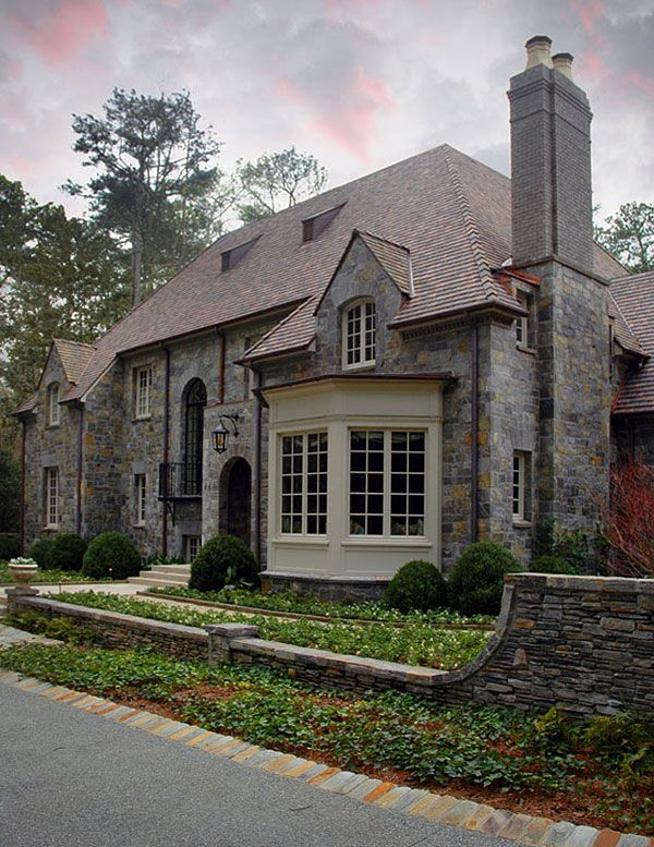 Stone Check Towering Hip Roof Check Dormers Arches Stone Fence Check Check Check Unexpected Littl With Images Home Styles Exterior House Exterior Architecture