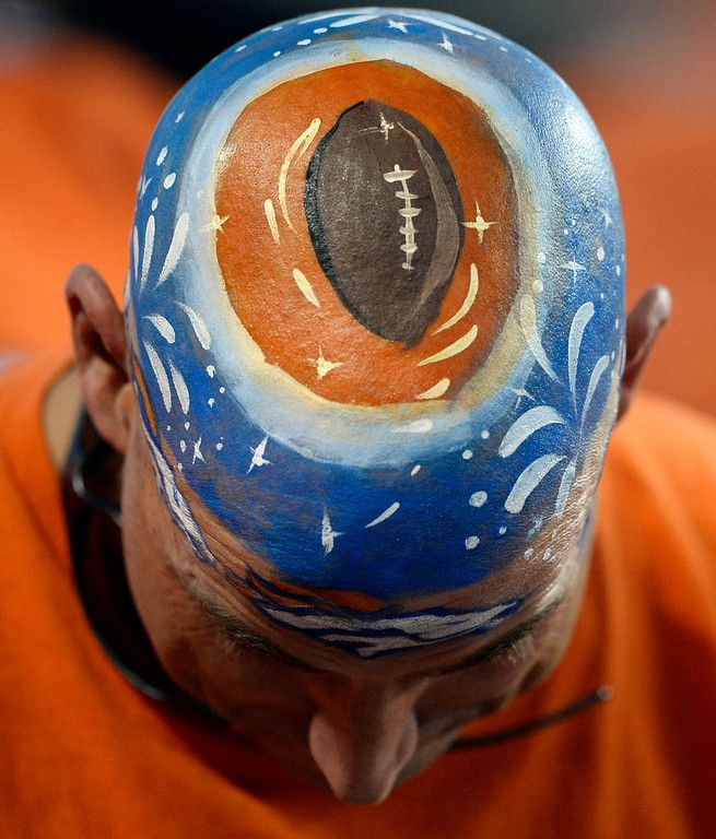 A Broncos fan sports a painted head during the first half of the game.  The Denver Broncos played the Indianapolis Colts at Sports Authority Field at Mile High in Denver, Colo. on September 7, 2014. (Photo by John Leyba/The Denver Post)-- #ProFootballDenverBroncos