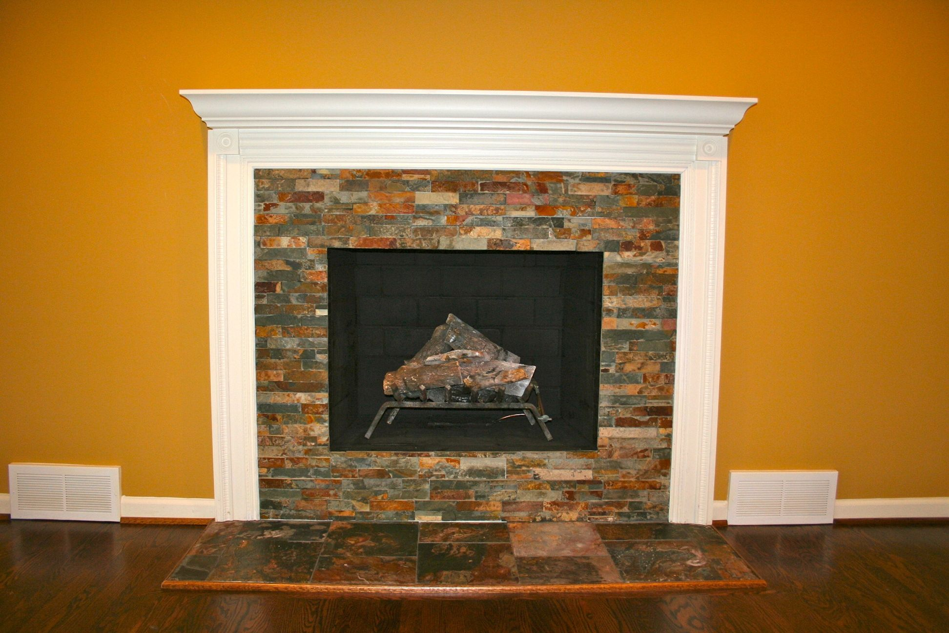 slate tile fireplace surround. slate fireplace surrounds with white mantle and oak floors  Google Search
