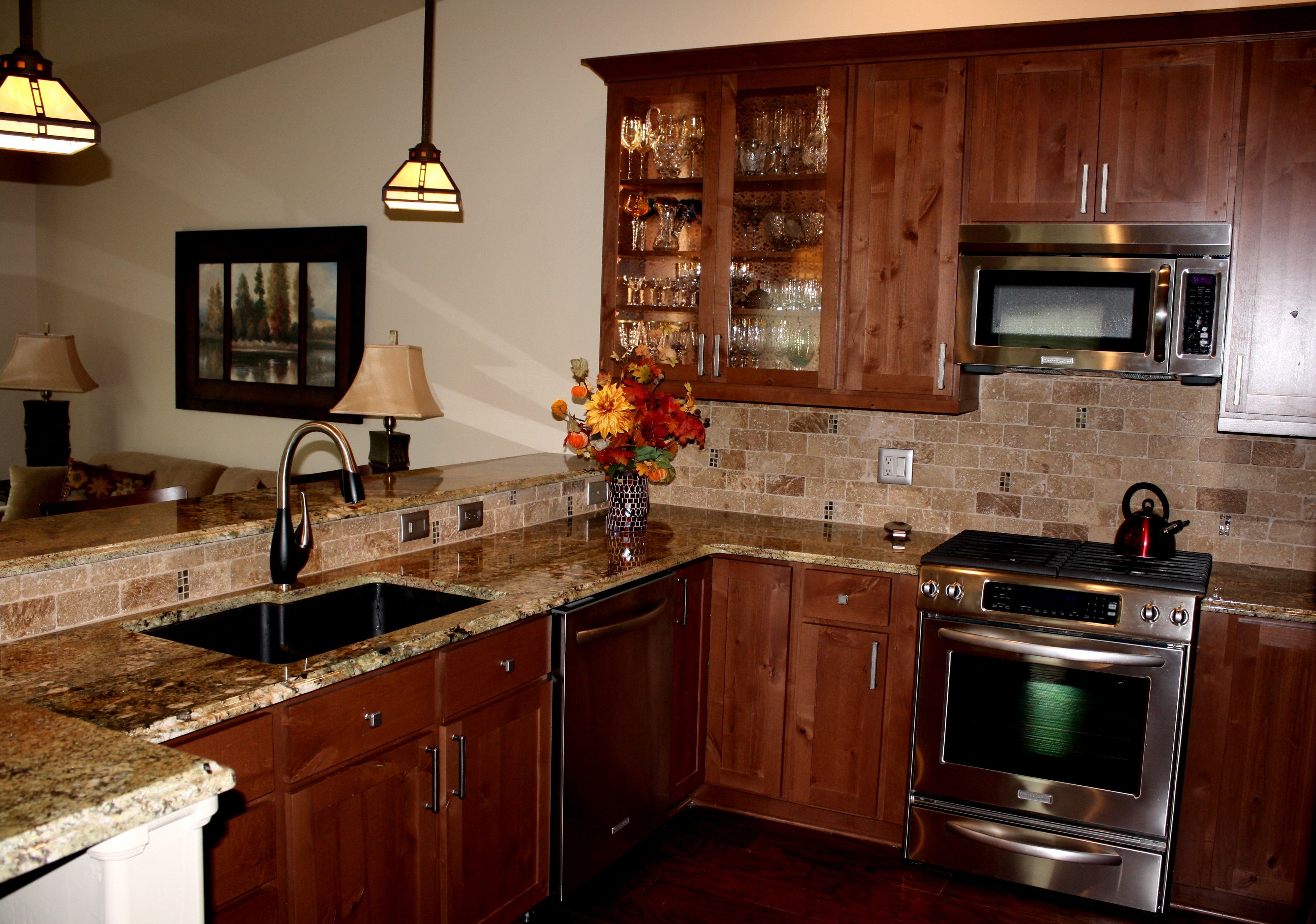 Carnival Granite With Tumbled Travertine Backsplash Kitchen