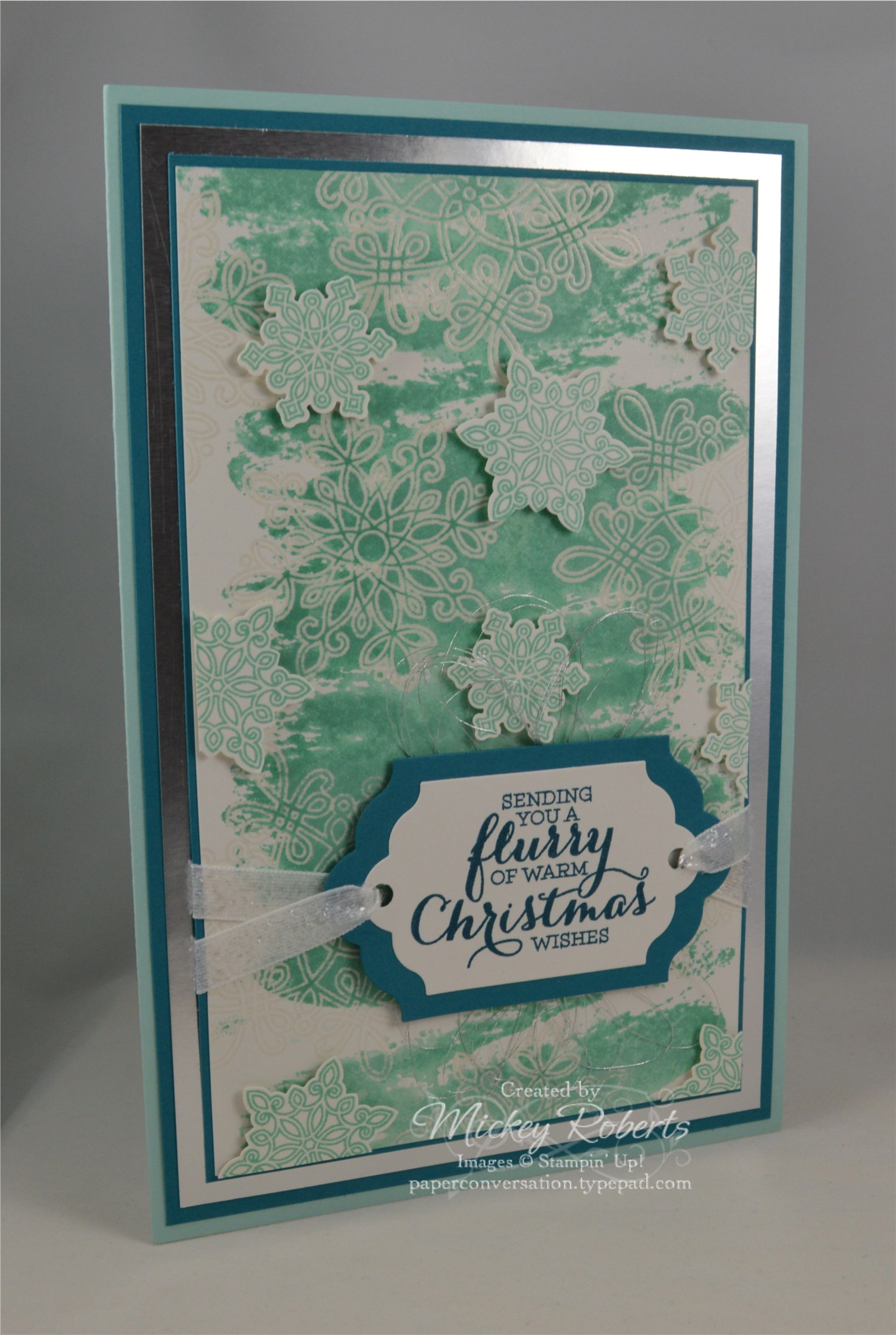 """Blog Post Date:  Dec 7, 2015.  An oversized card (card front is 8-1/2"""" x 5-1/2"""") featuring the Flurry of Wishes and Watercolor Wash stamp sets.  Other items used for this Christmas card include:  Clear Stampin' Emboss powder, Versamark ink, Pool Party and Island Indigo inks and cardstocks, Silver Foil Sheets, Shimmery White cardstock, Silver Metallic Thread, White 3/8"""" Glitter ribbon, Snow Flurry Punch, and the Lots of Labels Framelits with the Big Shot."""