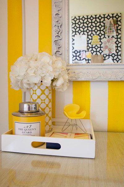 fun white yellow vertical stripes walls gray ornate mirror ...