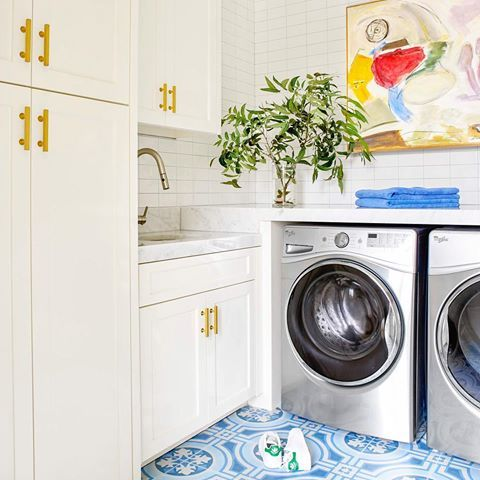 Laundry Room Ideas White Built In Cabinets With Brass Hardware Blue And White Tile Marble Countertops Interior Design By Collins Laundry Room Inspiration