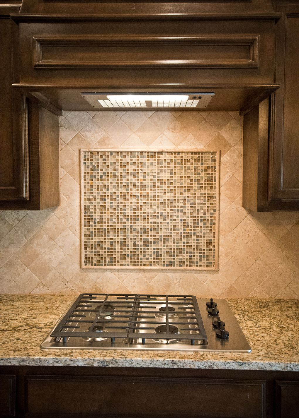 Beacon Homes Stamford Cooktop With Walnut Travertine Backsplash Mosaic Tile Accent