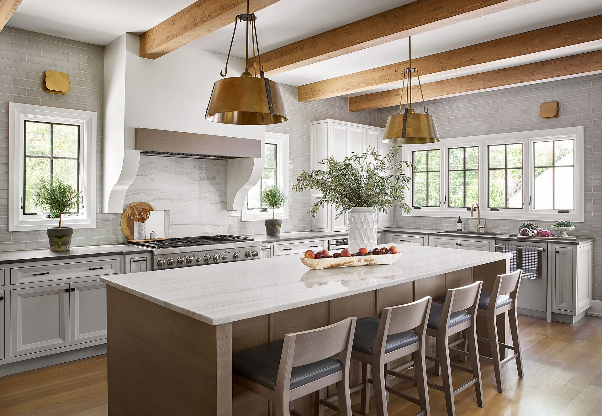 Modern Tudor kitchen with light ceiling beams, stucco ...