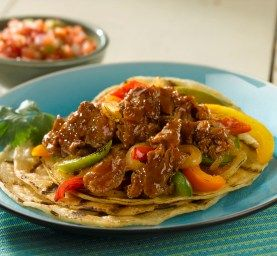 Steak Tostadas • using Old Neighborhood Shaved Steak For more recipes visit http://www.oldneighborhoodfoods.com/